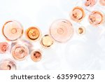 Stock photo many glasses of rose wine at wine tasting concept of rose wine and variety white background top 635990273
