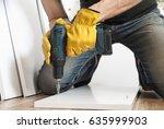 worker drills a hole when... | Shutterstock . vector #635999903