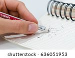 Stock photo pencil eraser removing a written mistake on a piece of paper delete correct and mistake concept 636051953