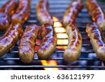 grilling sausages on barbecue... | Shutterstock . vector #636121997