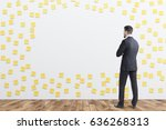 rear view of a businessman in... | Shutterstock . vector #636268313