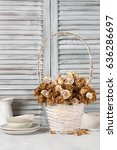 Dried Roses In White Wicker...