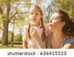 mother and daughter blowing... | Shutterstock . vector #636415523