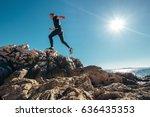 man runs on rocky sea side | Shutterstock . vector #636435353