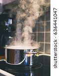 water steaming from a steel pot ... | Shutterstock . vector #636441047