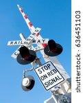 a railway crossing signal in... | Shutterstock . vector #636451103