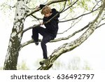 Young Child Blond Boy Climbing...