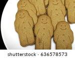 a plate of gingerbread men... | Shutterstock . vector #636578573