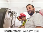 kid traveling by airplane | Shutterstock . vector #636594713