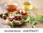 crostini with rocket  sundried... | Shutterstock . vector #636596657