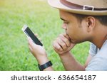 young man wear hat sit using...   Shutterstock . vector #636654187