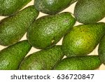 Small photo of Avocado, alligator pear regular background. Macro. Full of details. Avocado or alligator pear is a fruit, botanically a large berry that contains a single seed.