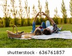 happy couple in love  lying on... | Shutterstock . vector #636761857