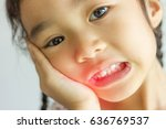 asian kid have dental problems. | Shutterstock . vector #636769537