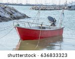 A Small Red Color  Dinghy With...