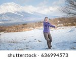 female playing snow at mt.fuji...   Shutterstock . vector #636994573