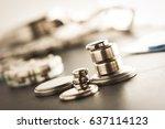 closeup button cell battery or... | Shutterstock . vector #637114123