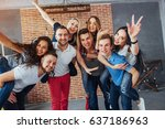Small photo of portrait of multi-ethnic boys and girls with colorful fashionable clothes holding friend and posing on a brick wall, Urban style people having fun, Concepts about youth and togetherness lifestyle.