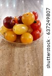 Small photo of cherry tomato is a rounded, small fruited tomato thought to be an intermediate genetic admixture between wild currant-type tomatoes and domesticated garden tomatoes, small size, varieties in colors.