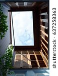 Small photo of Blue airy terrace with brown wooden window on the second floor, bottom view - architecture concept