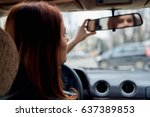 woman looking in rear view... | Shutterstock . vector #637389853