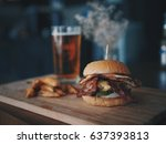 meat burger in cafe | Shutterstock . vector #637393813