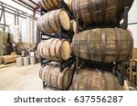 stack of barrels in cellar with ... | Shutterstock . vector #637556287