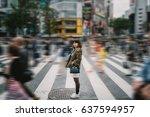 portrait girl crossing busy...   Shutterstock . vector #637594957