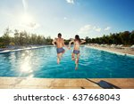 couple jumping into pool.... | Shutterstock . vector #637668043