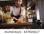 chef placing tooth pick over... | Shutterstock . vector #637820617