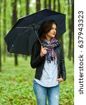 Young Woman With Umbrella...