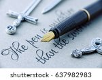 "Small photo of Fountain pen and swords on a paper printed with proverb ""The pen is mightier than the sword"". This phrase is a metonymic adage, indicating that a journalist can report lie or truth using only a pen."