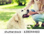 Stock photo family pet animal and people concept close up of woman with labrador dog on walk in park 638044483