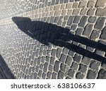 stone street with a shadow of a ... | Shutterstock . vector #638106637