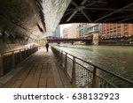 man on chicago river walk under ...