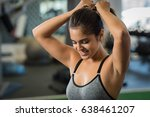athlete tying hair before her... | Shutterstock . vector #638461207