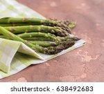 fresh asparagus on concrete... | Shutterstock . vector #638492683