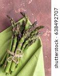 fresh asparagus on concrete... | Shutterstock . vector #638492707