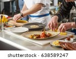professional cooks working ... | Shutterstock . vector #638589247