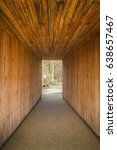 Small photo of Wooden Passageway Outside - Modern Abstract Architecture