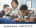 boys playing video games and... | Shutterstock . vector #638717173