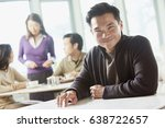 smiling asian man sitting in... | Shutterstock . vector #638722657