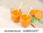 fresh carrot juice in cups on...