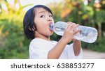 little girl drinking water. | Shutterstock . vector #638853277