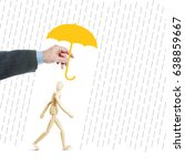 Small photo of Man protects another person from adversity by covering him with an umbrella. Conceptual image with a wooden puppet