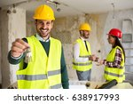 young worker holding the key ...   Shutterstock . vector #638917993