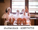 group of famale friends in spa... | Shutterstock . vector #638974753