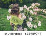 a cute little baby in a sling... | Shutterstock . vector #638989747