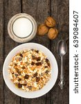 white bowl with granola or... | Shutterstock . vector #639084607