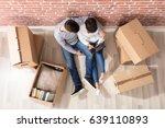young couple sitting between... | Shutterstock . vector #639110893